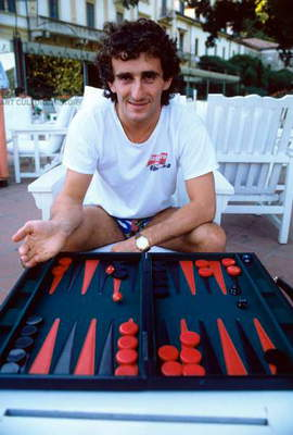 Alain Prost plays backgammon.