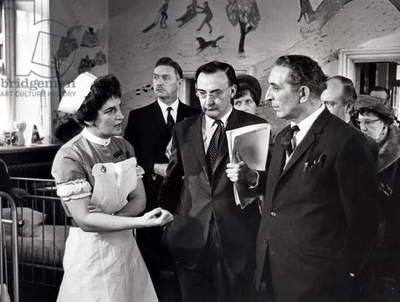 The Secretary of State for Wales, Mr. George Thomas, talks to Deputy Sister Margaret Hicks, in one of the wards at Ely hospital, 1969 (b/w photo)