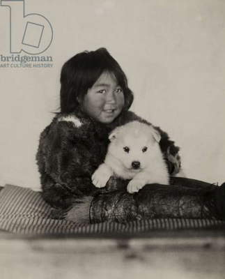 Eskimo girl with a white sled and a puppy, Etah, Greenland, 1920 (b/w photo)