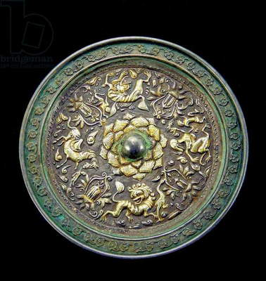 China: Bronze mirror with silver inlay decorated with a lotus flower and mythical animals, Tang Dynasty (618-906 CE)