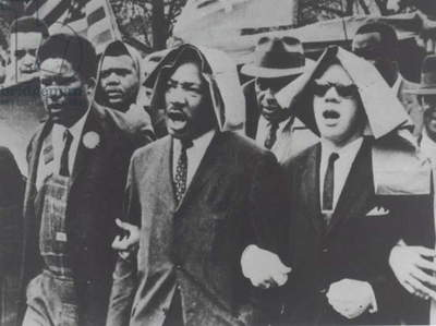 Martin Luther King taking part in a Civil Rights protest march, Montgomery, Alabama, 1965 (b/w photo)