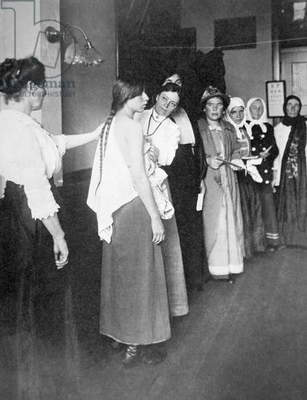 European women undergo medical examination on Ellis Island, New York, c.1900 (b/w photo)