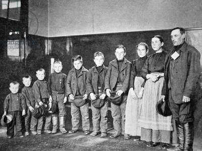 A migrant Polish family at Ellis Island, New York, 1910 (b/w photo)