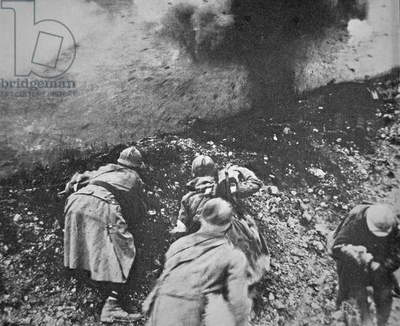 French infantry under fire from German artillery during the Battle of Verdun, 1916 (b/w photo)