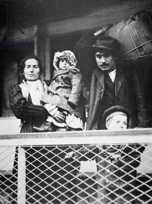 A migrant Italian family on the ferry from Ellis Island to New York City, 1905 (b/w photo)