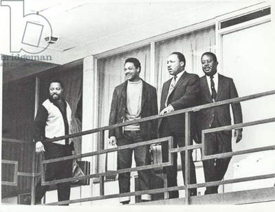 Martin Luther King standing on the balcony of the Memphis hotel the day before he was shot dead at the same spot, 3rd April 1968 (b/w photo)