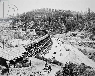 Chinese labourers working on a trestle bridge on the western slope of the Sierra Nevada mountains, 1867 (b/w photo)