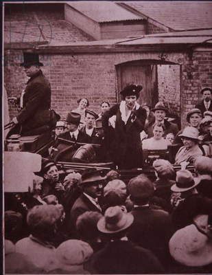 Lady Astor, first woman to take her seat as a Member of Parliament, campaigning for office, 1939 (b/w photo)