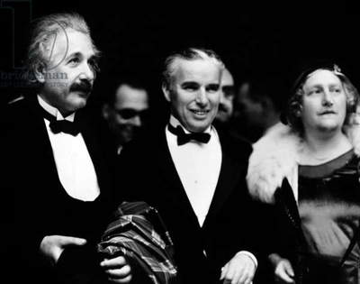 The swiss theoretical physicist of german origin Albert Einstein (1879-1955) and his wife Elsa (r) with the swiss and english director and actor, Charlie Chaplin at premiere of film City Lights at the Los Angeles theater january 30, 1931