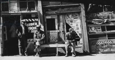 Vicksburg Negroes and shop front. Mississippi 1936