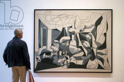 Man standing in front of 'The Charnel House' by Pablo Picasso at the Museum of Modern Art, New York (photo)