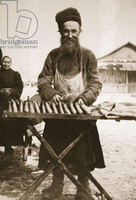Russian peasant selling meat pies, c.1910 (sepia photo)