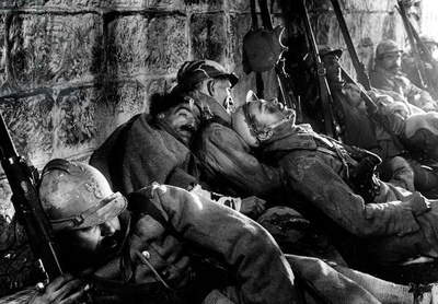 French soldiers rest at during a lull in the battles of Verdun in 1915 and 1916, scene from the German documentary 'The Struggle for Verdun', 1934 (b/w photo)