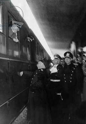 Benito Mussolini and Count Galeazzo Ciano welcome Adolf Hitler at the station, 1940 (b/w photo)