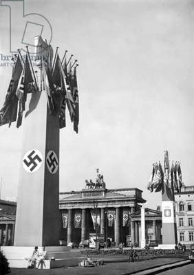 Pylons decorated with Swastikas in front of Brandenburg Gate for the visit of the Italian Foreign Minister, Berlin, 1939 (b/w photo)