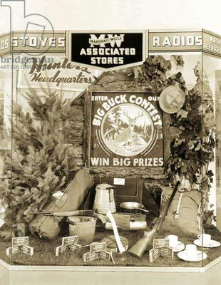Oregon: c.1937 A 'Big Buck Contest' hunting display window at a Marshall-Wells hardware store.  (b/w photo)