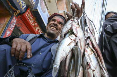 A vender selling fishes in Kathamdu. Nepal. December 22, 2005.  (photo)