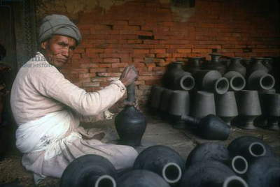 Kathmandu valley. The town of Bhaktapur is well known for its potters. The pots can be seen drying out in the squares, Nepal.  (photo)