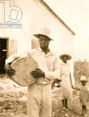 Man posing holding a drum, Cat Island 1935 (photo)