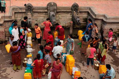 Scarcity of pure drinking water is acute in Patan as well as in Kathmandu. People stand for hours to fill their buckets and plastic containers from the ancient stone spouts or hitis. Patan (photo)