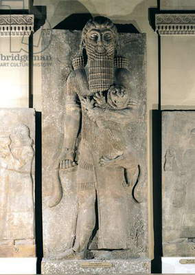 The hero Gilgamesh holding a lion that he has captured, stone relief from the Palace of Sargon II at Khorsabad (Iraq), c.725 BC (gypsum)