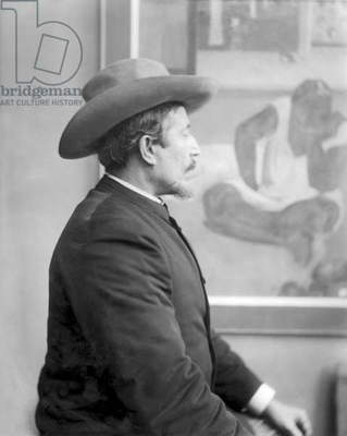 Paul Gauguin (1848-1903) in front of his canvases, c.1893 (b/w photo)