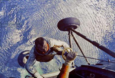 Astronaut Alan B. Shepard is hoisted aboard a U.S. Marine helicopter after splashdown of his Freedom 7 Mercury space capsule on May 5 1961 (colour photo)