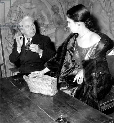 Charlie Chaplin With his Wife Oona Dining at Famous Parisian Restaurant Tour D'Argent October 1952 (b/w photo)