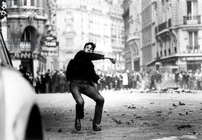 Student Throwing Cobblestones during Demonstration in Paris on May 25, 1968 (b/w photo)