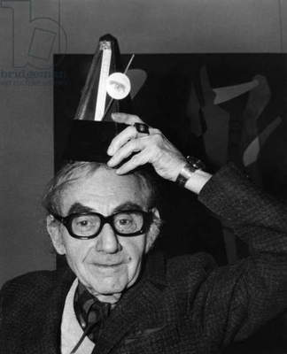 Man Ray Exhibition in Paris on January 6, 1972 : Man Ray With One of his Works (b/w photo)