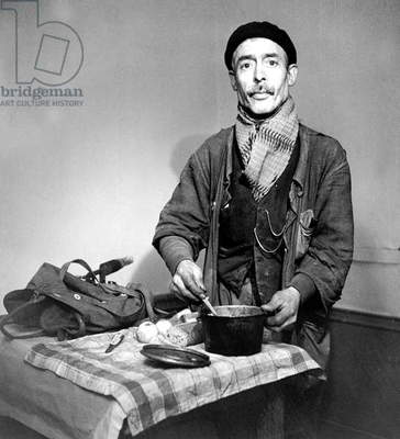 Worker Fixing A Meal January 1945 (b/w photo)