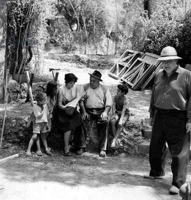 Filming of The Film Le Dejeuner Sur L'Herbe. during A Break : Director Jean Renoir (On The Right), Catherine Rouvel, Fernand Sardou and Three Children in Cannes July 11, 1959  (b/w photo)