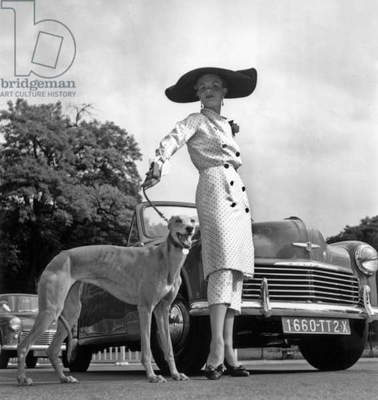 Concourse of Excellence in Paris (Bois De Boulogne) June 26, 1952 : A Woman Dressed By Paquin and her Greyhound, Hillman Car (b/w photo)