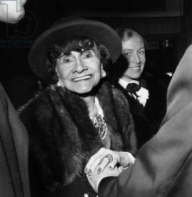 Coco Chanel at the Premiere of the film Borsalino on March 20, 1970 in Paris (b/w photo)
