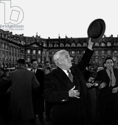 Charlie Chaplin in Front of Ritz Hotel in Paris October 30, 1952 (b/w photo)