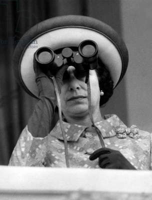 Queen Elizabeth Ii of England Watching Horse Races With Binoculars, Especially The Special Race