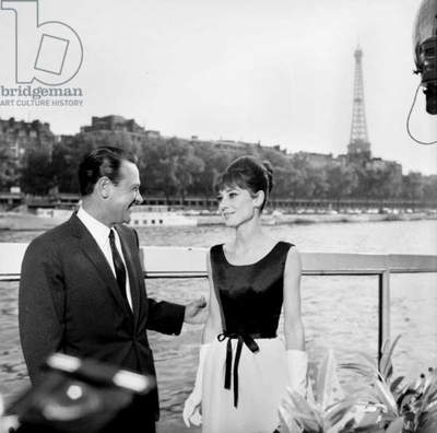 Actors William Holden and Audrey Hepburn on the set of the film