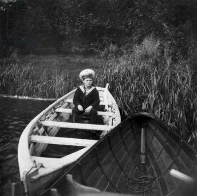 Czarevitch Alexis Nicolarevitch (1904-1918) haemophiliac son of russian czar NicolasII (Romanov dynasty) here in Peterhof in a small boat, 10's