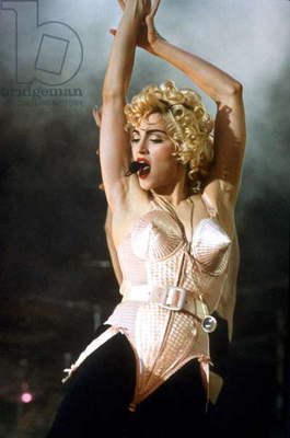 Madonna (wearing Jean-Paul Gaultier clothes) performing during the Blonde Ambition tour 1990