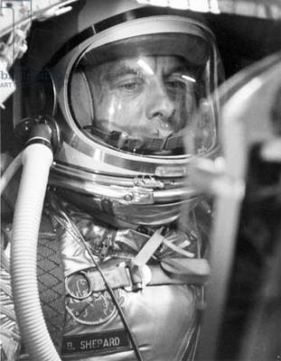 A closeup of Astronaut Alan Shepard in his space suit seated inside the Mercury capsule. He is undergoing a flight simulation test with the capsule mated to the Redstone booster April 29, 1961 (Mercury project)