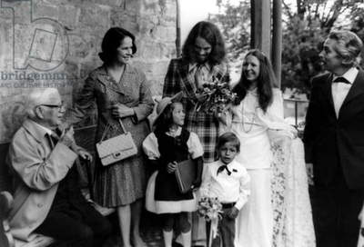 Wedding of Eugene Chaplin, 5th child of Charles Chaplin (bench) and his 4th wife  Oona O'Neill (standing on l) on august 12, 1974 with Sandra Guignard in Brent sur Montreux, Switzerland (b/w photo)