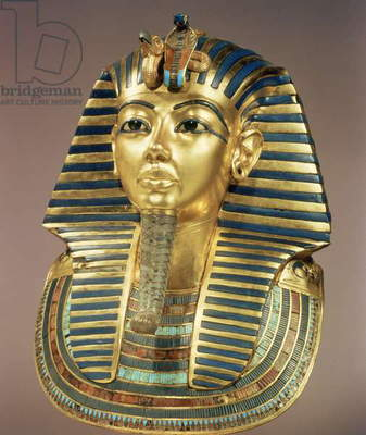 The gold funerary mask, from the tomb of Tutankhamun (c.1370-52 BC) New Kingdom (gold in laid with semi-precious stones & glass paste) (see also 3981)