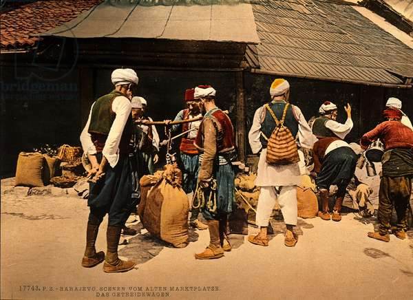 Men in traditional dress, weighing sacks of cereal, Sarajevo during the Austro-Hungarian Empire, c.1900-10 (photo)