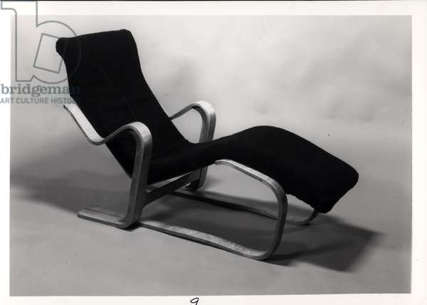 Isokon Long Chair with an upholstered cushion, designed for the Isokon Furniture Company by Marcel Breuer (1902-81) 1935-6 (laminated birch plywood) (b/w photo)