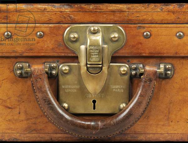 Detail from one of two suitcases (leather with brass fittings)