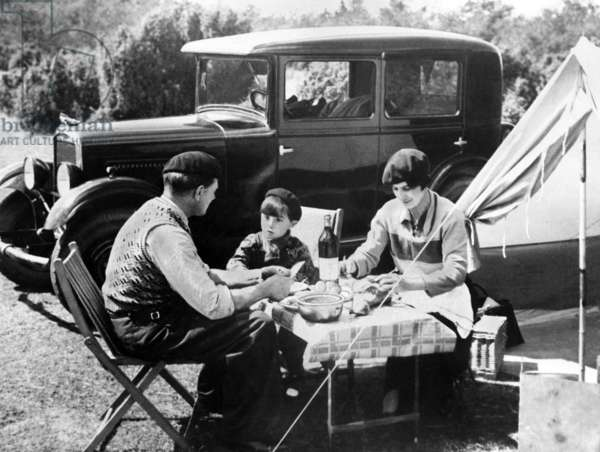 French familly having picnic lunch in France, c 1936