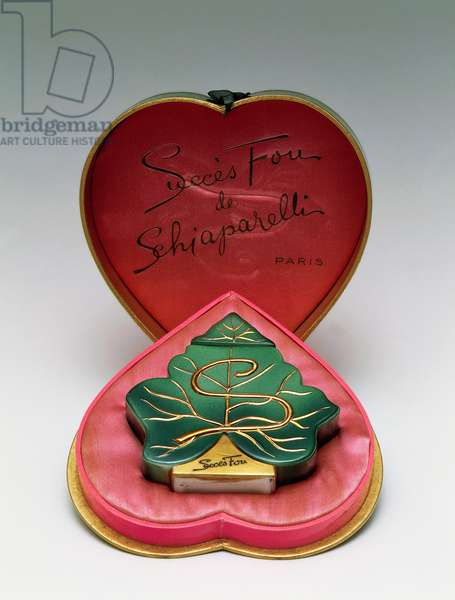 Bottle for the perfume Succes fou (Crazy success) by Elsa Schiaparelli (1890-1973), ca 1945, leaf-shaped box covered with coloured with shocking pink satin. France, 20th century.