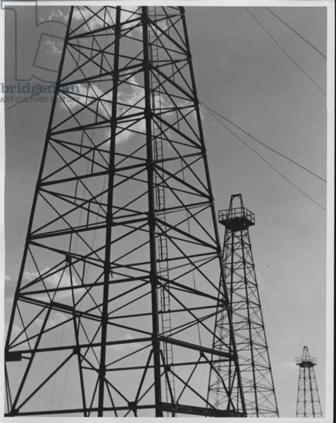 Three Oil Derricks, Texas, 1935-36 (b/w photo)