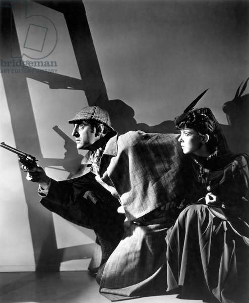 THE ADVENTURES OF SHERLOCK HOLMES, 1939 directed by ALFRED WERKER Basil Rathbone and Ida Lupino (b/w photo)