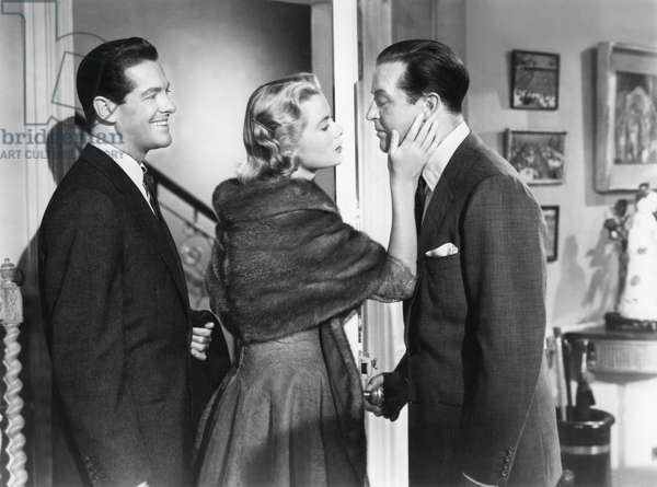 DIAL M FOR MURDER, 1954 directed by ALFRED HITCHCOCK Robert Cummings, Grace Kelly and Ray Milland (b/w photo)